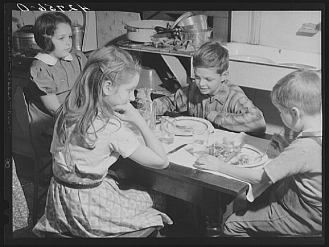 The children's table at the Crouch family Thanksgiving Day dinner. Ledyard, Connecticut, 1940.